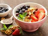 Oatmeal porridge with nuts and berries for a healthy breakfast