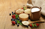 Set of different cereals for porridge with milk and berries