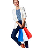Happy woman with shopping bags posing against white background