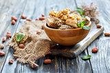 Wooden bowl with mint and honey bars with nuts and seeds.