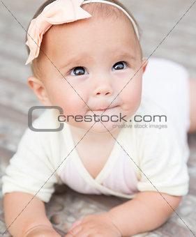 Baby girl crawling outside