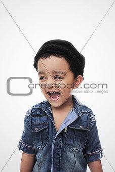 Portrait. happy little south asian boy wearing cultural hat