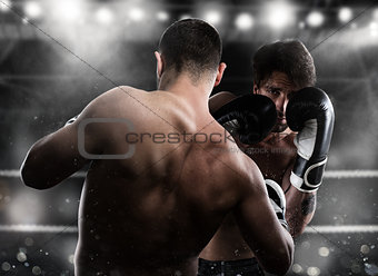 Boxer in a boxe competition beats his opponent