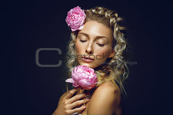 Beautiful girl with peony flower