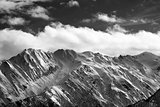 Black and white snow winter mountains and cloud sky in sun eveni