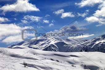 Ski slope and beautiful sky with clouds in sunny evening