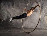 Circus artist in aCyr Wheel