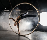Circus artist in aCyr Wheel