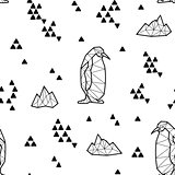 Seamless black and white kids tribal vector pattern with penguins and triangles.