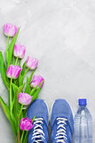 Spring flatlay sports composition with blue sneakers and purple