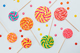 Pattern sweet lollipops, candy on white background, top view fla