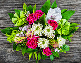 wedding bouquet with roses and white gerberas, view from above