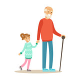 Grandfather And Girl Walking Holding Hands, Part Of Grandparents Having Fun With Grandchildren Series