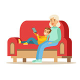 Grandmother And Boy Reading Electronic Book, Part Of Grandparents Having Fun With Grandchildren Series