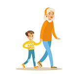 Grandmother Walking With Boy Holding Hands, Part Of Grandparents Having Fun With Grandchildren Series