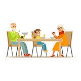 Grandfather, Grandmother And Boy Having Dinner, Part Of Grandparents Having Fun With Grandchildren Series