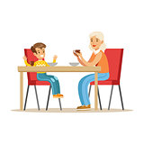 Grandmother Having Breakfast With Boy, Part Of Grandparents Having Fun With Grandchildren Series