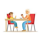 Grandmother Having Breakfast With Boy, Part Of Grandparents Having Fun With Grandchildren Series