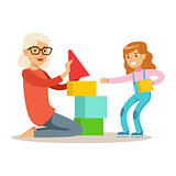 Girl And Grandmother Building Pyramid From Blocks, Part Of Grandparents Having Fun With Grandchildren Series
