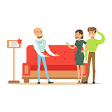 Store Seller Selling Red Sofa To Couple, Smiling Shopper In Furniture Shop Shopping For House Decor Elements