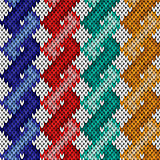 Knitting seamless pattern with twisted ropes