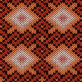 Ornate knitting seamless pattern in warm hues