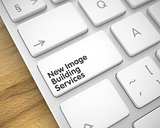 New Image Building Services - Message on White Keyboard Key. 3D.