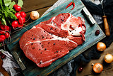 Fresh beef veal meat on rustic tray