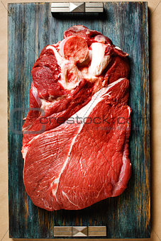 Top view of beef meat on wooden tray