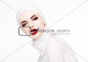 Beautiful model holding syringe in lips surgery