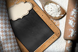 Empty Blackboard with Flour and Rolling Pin