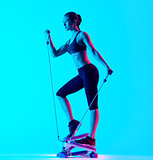 woman exercsing Stepper fitness exercices isolated