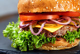 Classic hamburger macro with black background and selective focus