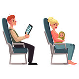 Airplane passengers - woman with baby and man reading tablet