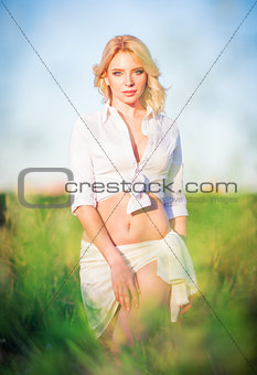 Beautiful young girl standing in the field.