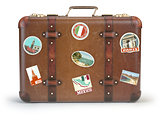 Vintage suitcase with travel stickers isolated on white backgrou