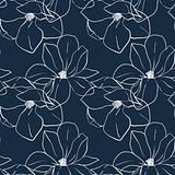 Trendy seamless floral print with magnolia flowers on deep blue color. Vector hand drawn illustration for print,textile,wrapping paper.
