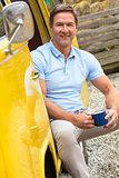 Handsome Middle Aged Man Drinking Tea coffee in Camper Van Bus
