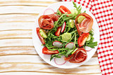 Salad with parma ham, arugula and tomatoes