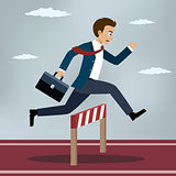 Businessman jumping over hurdle.