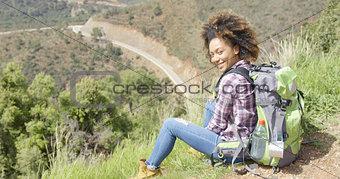 Beautiful female traveler on mountain