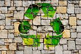 Stone wall with recycle symbol