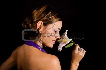Beauty smelling a flower