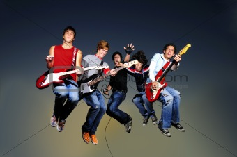 group of musicians jumping