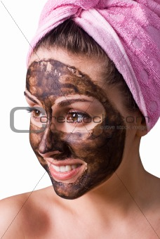 Beautiful girl with mud mask on face