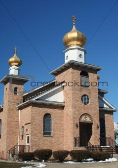 Brick church against a blue sky