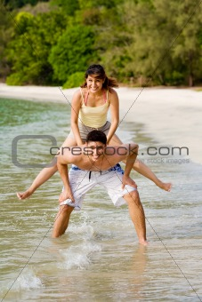 woman jump from the back of a guy
