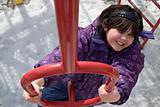 Girl Climbing Playground Equipment