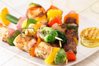 three meats plate with vegetables