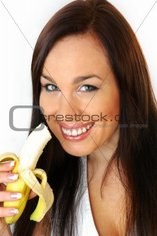 brunette eating a banana
